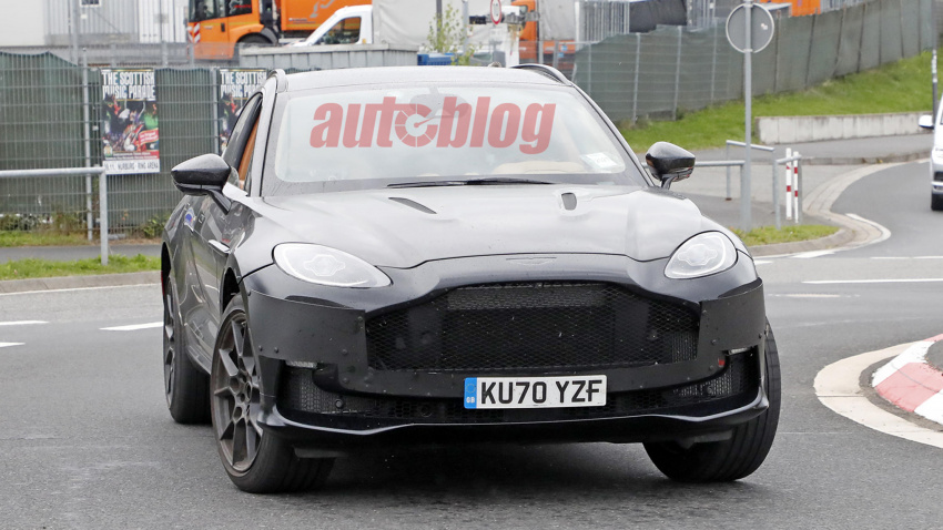 aston martin dbx spy photos show what may be a v12 model