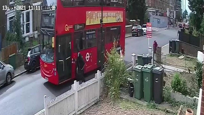 video: man hails a bus by standing in the middle of the road